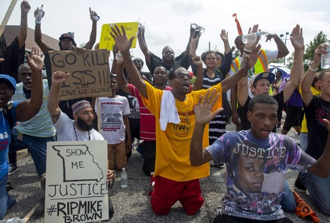 Demonstrators mark one year anniversary on police shooting