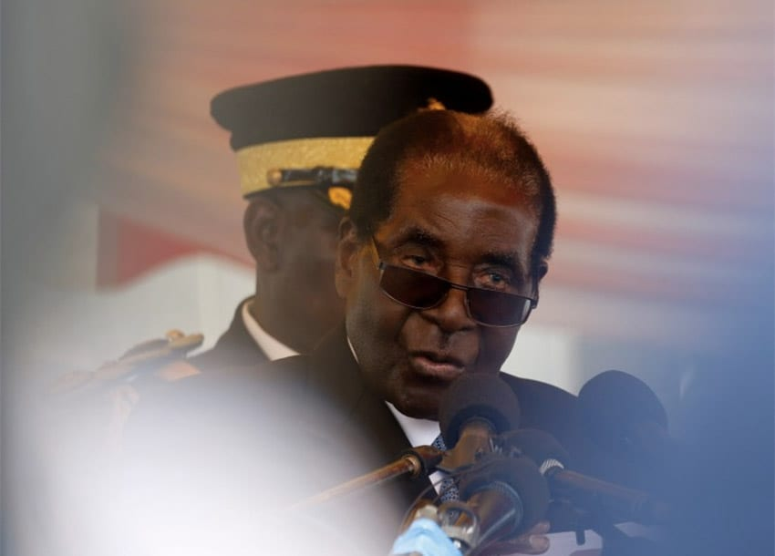 "Zimbabwe threatens ""traitorous"" war veterans after Mugabe attack"