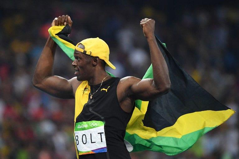 'Lightning' strikes thrice as Bolt completes 100m hat-trick