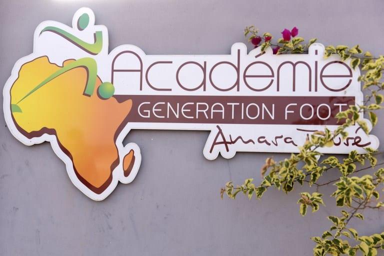 A picture taken on June 14, 2017 in Deni Biram Ndao, eastern Dakar shows the Generation Foot Academie football academy's logo.  AFP PHOTO / SEYLLOU