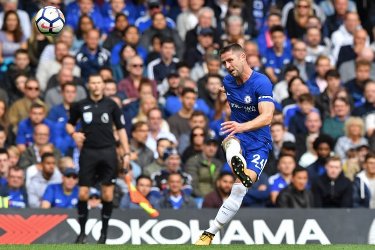 Chelsea's English defender Gary Cahill aims a pointed pass during the explosive clash.Image/AFP