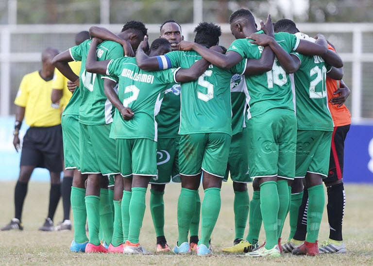 Gor Mahia players cluster in a prayer before kick off against Thika United. Gor are closing in on a 16th league title .Image/SPORTPICHA