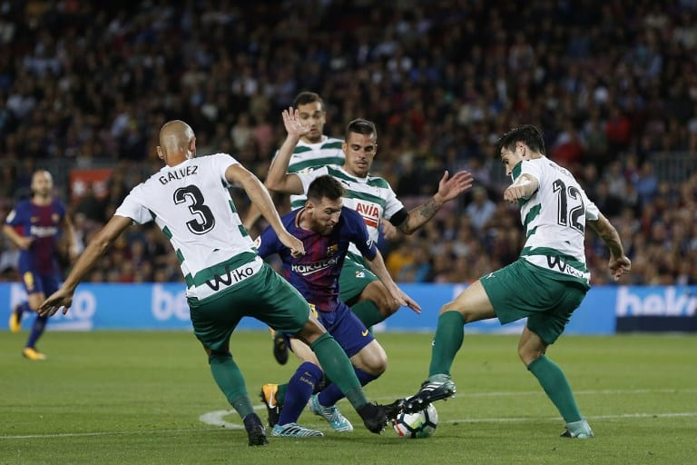 Barcelona's forward from Argentina Lionel Messi (C) tries to weave his way past several Eibar players during their league match at the Camp Nou stadium in Barcelona on September 1.9 AFP PHOTO