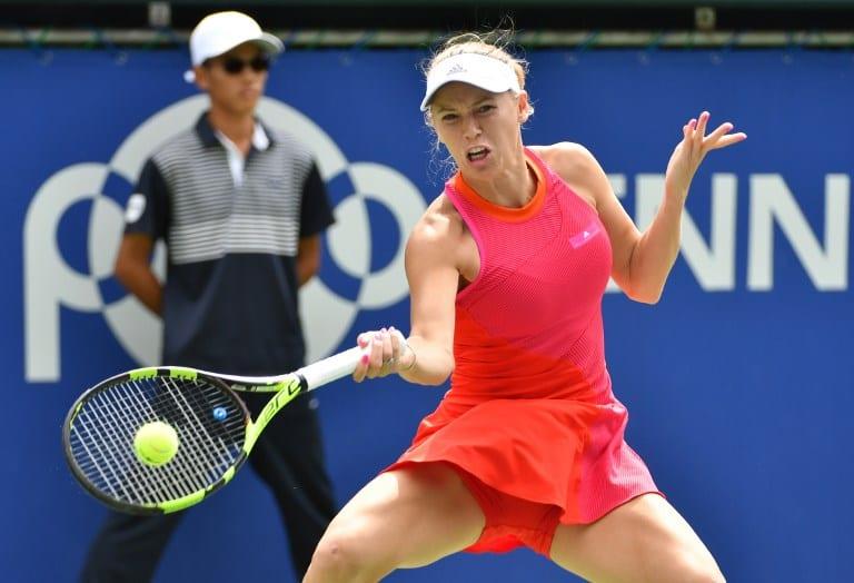 Wozniacki whips Russian to retain Tokyo crown