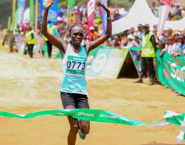 Safaricom athletics series 2017 Madoka half marathon winner women category Nancy Kiprop celebrates as she crosses the finishing line in Ngerenyi grounds Wundanyi Taita Taveta County. Nancy won in 1.14.05.17 ahead of Naomi Jebet who emerged number two in 1.14.11.19