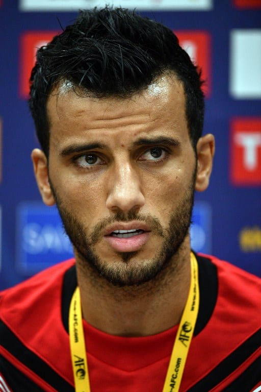 Syria's player Omar Al Soma speaks at a press conference in Sydney on October 9, 2017, on the eve of their 2018 World Cup football qualifying match against Australia. / AFP PHOTO.