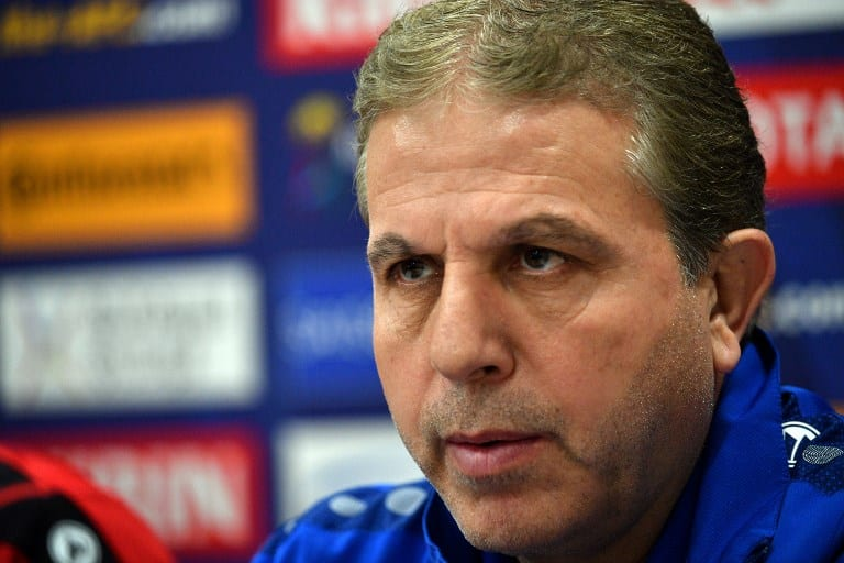 Syria coach Ayman Alhkeem speaks at a press conference in Sydney on October 9, 2017, on the eve of their 2018 World Cup football qualifying match against Australia. / AFP PHOTO.