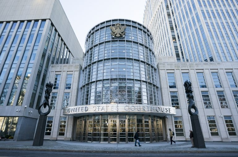 The Federal Courthouse in Brooklyn is seen in New York where Juan Ángel Napout of Paraguay, José Maria Marin of Brazil, and Manuel Burga of Peru are on trial in the Fifa corruption scandal on November 15, 2017. A former Argentine football official has reportedly committed suicide after he was accused of bribe-taking in testimony to a trial of top former FIFA figures in New York. Jorge Delhon threw himself under a train in a Buenos Aires suburb on November 14, 2017, Argentine newspapers Clarin and La Nacion reported on their websites. / AFP PHOTO / DON EMMERT