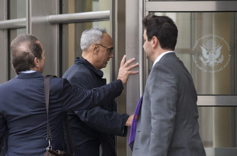Manuel Burga, Former president of the Peruvian Football Association, arrives at Brooklyn Federal Court November 6, 2017 in New York. AFP PHOTO / Don EMMERT