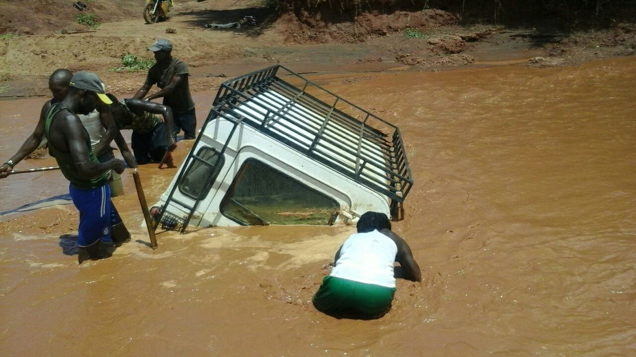 PHOTOS: Vehicle carrying KCSE exam papers swept by floods
