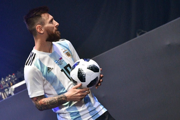 Barcelona and Argentina forward Lionel Messi poses with the official match ball for the 2018 World Cup football tournament, named
