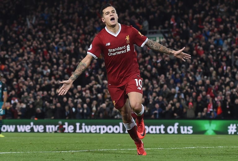(FILES) This file photo taken on November 18, 2017 shows Liverpool's Brazilian midfielder Philippe Coutinho celebrating scoring his team's third goal during the English Premier League football match between Liverpool and Southampton at Anfield in Liverpool, north west England on November 18, 2017. When Philippe Coutinho joined Liverpool in 2013, the Brazil forward was so lightly regarded that his signing was overshadowed by the arrival of Daniel Sturridge at Anfield earlier that month. But five years later, Coutinho has become such an formidable force that his departure will be mourned by Liverpool fans around the world if Barcelona complete their bid to land the Reds star in a blockbuster transfer. / AFP PHOTO / PAUL ELLIS / RESTRICTED TO EDITORIAL USE. No use with unauthorized audio, video, data, fixture lists, club/league logos or 'live' services. Online in-match use limited to 75 images, no video emulation. No use in betting, games or single club/league/player publications. / TO GO WITH AFP PROFILE STORY BY STEVEN GRIFFITHS