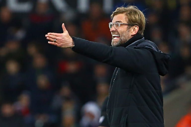 Liverpool's German manager Jurgen Klopp celebrates on the pitch after the English Premier League football match between Burnley and Liverpool at Turf Moor in Burnley, north west England on January 1, 2018. Liverpool won the game 2-1. / AFP PHOTO / Oli SCARFF