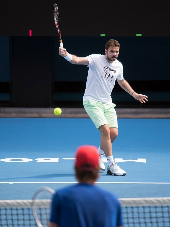 This handout photo released and taken on January 9, 2018 by Tennis Australia shows Stan Wawrinka of Switzerland during a practise session ahead of the Australian Open tennis tournament, at Margaret Court Arena in Melbourne. / AFP PHOTO / TENNIS AUSTRALIA / Elizabeth BAI