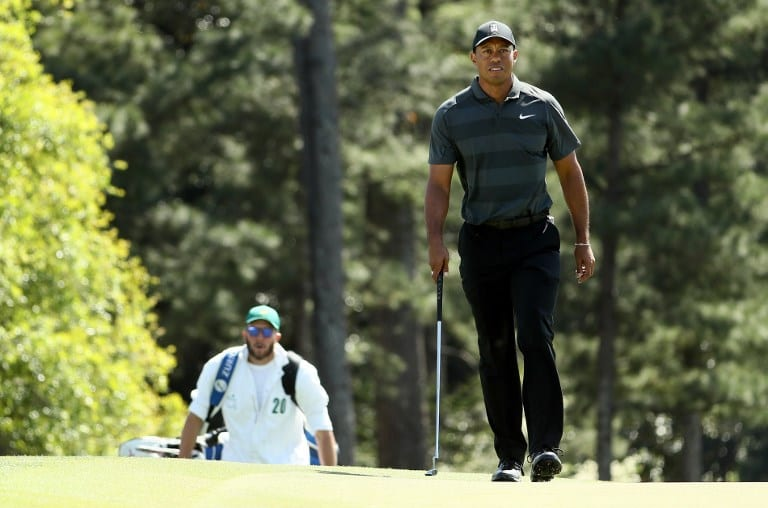 Tiger battles through with clutch shots in Masters return