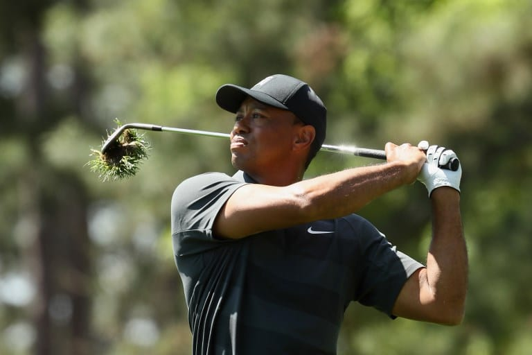 AUGUSTA, GA - APRIL 05: Tiger Woods of the United States plays an approach shot on the ninth hole during the first round of the 2018 Masters Tournament at Augusta National Golf Club on April 5, 2018 in Augusta, Georgia.   Jamie Squire/Getty Images/AFP