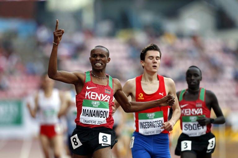 Athletics - 2018 IAAF World U20 Championships – men's 1500m – Tampere, Finland – July 12, 2018. George Meitamei Manangoi of Kenya crosses the finish line ahead of Jakob Ingebrigtsen of Norway. Lehtikuva/Kalle Parkkinen via REUTERS