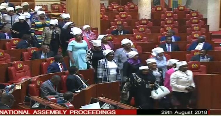 MPs wear white headgear to Parliament over two-thirds gender rule