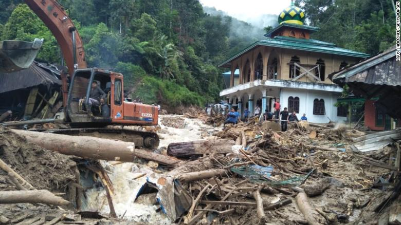 20 killed as mudslides wipe out part of school in Indonesia