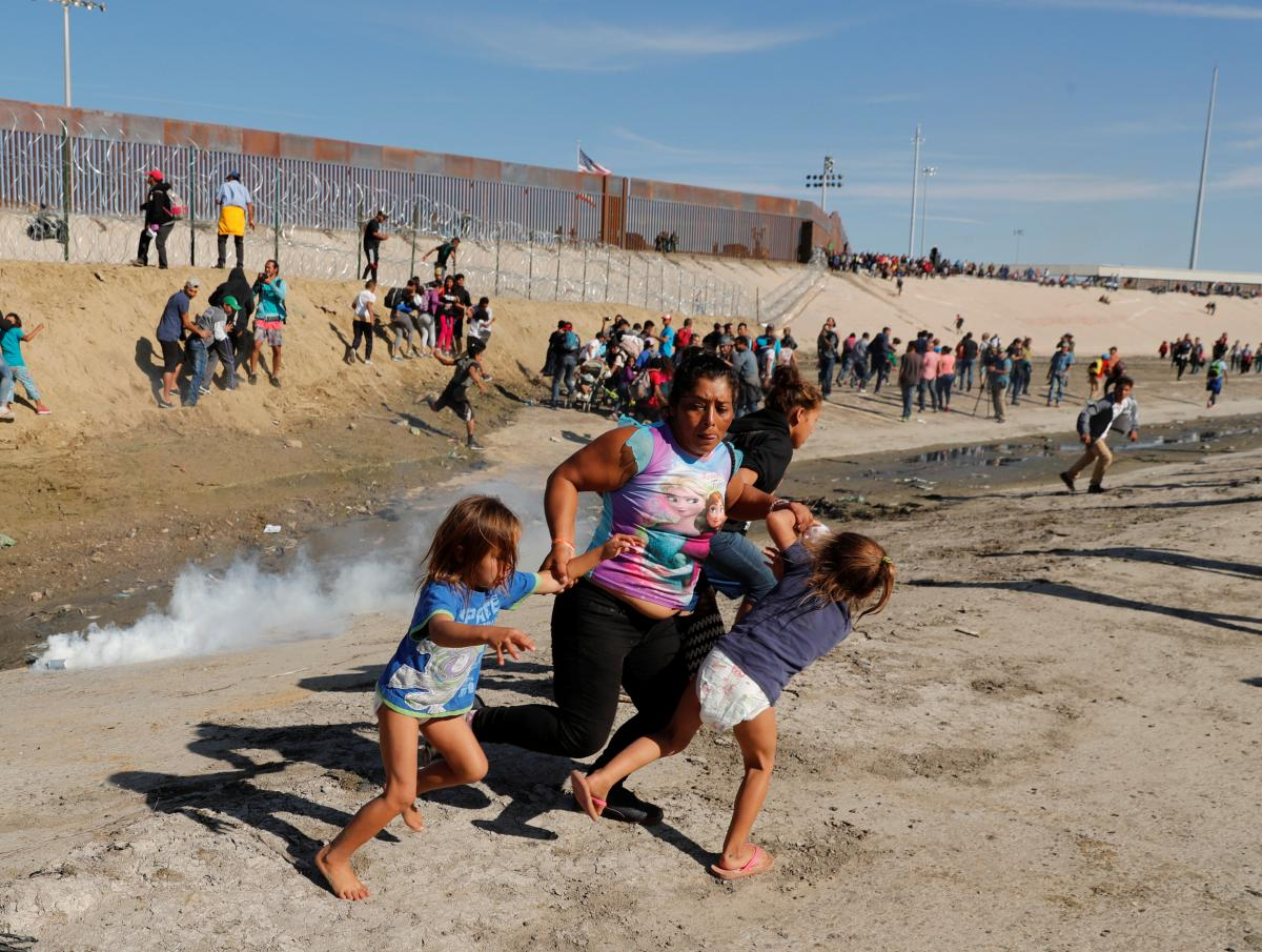 U.S. fires tear gas into Mexico to repel migrants, closes border gate for several hours