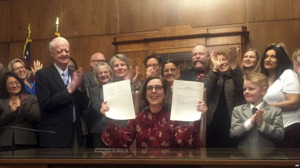 Oregon OKs 1st statewide mandatory rent control law in US