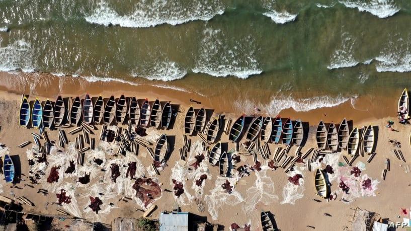 Empty nets as overfishing and climate change sap Lake Malawi