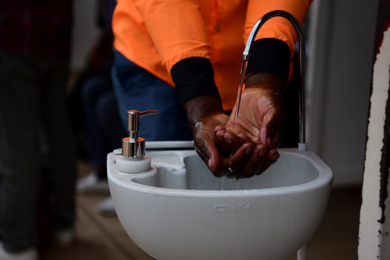 Rwanda keeping coronavirus at bay with public handwashing sinks at bus stops, banks, shops