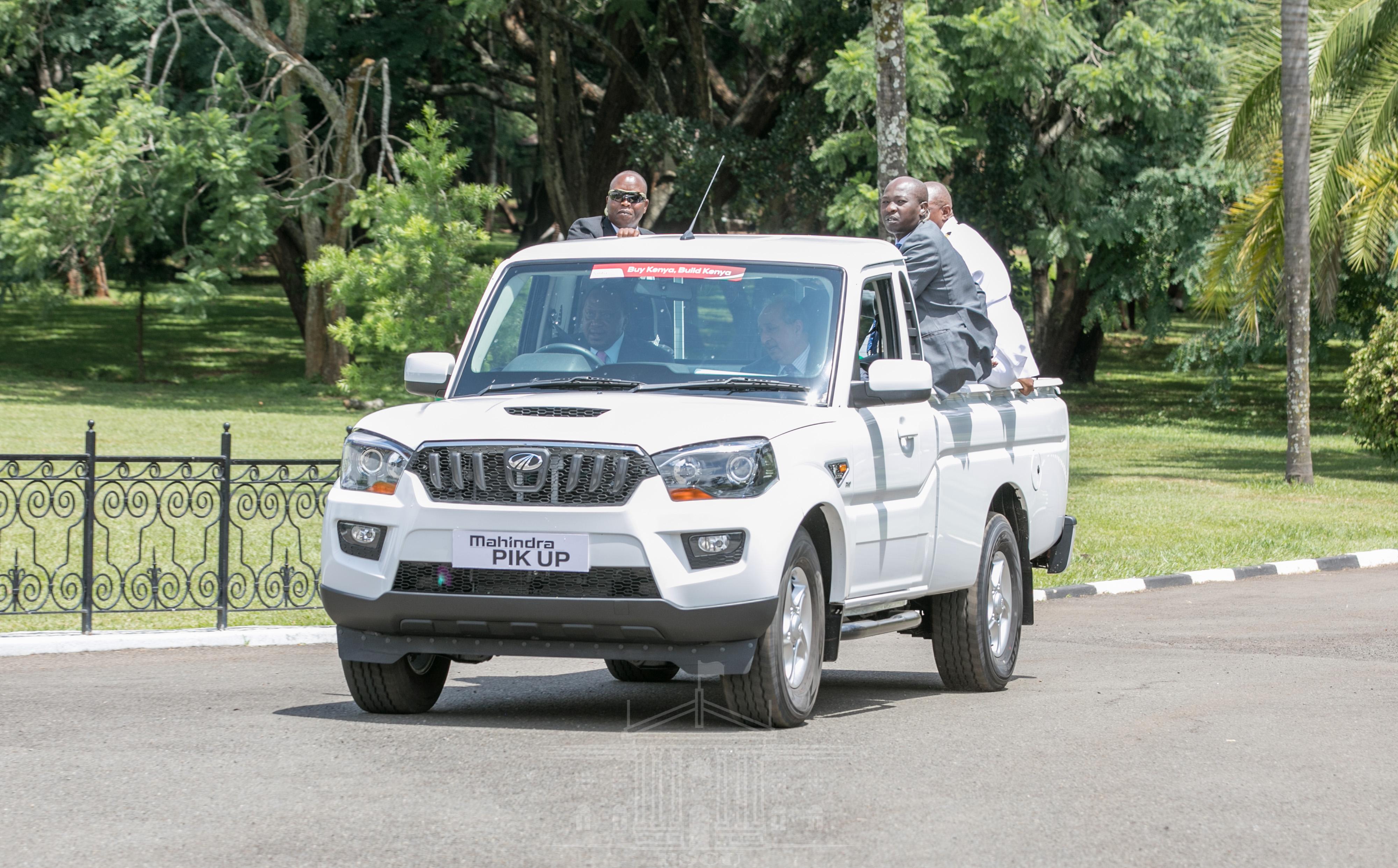 Uhuru unveils first locally assembled Mahindra vehicles