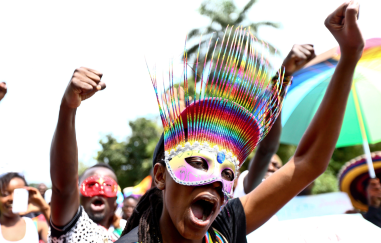 FILE - People parade in celebration of the annulment of an anti-homosexuality law by Uganda's constitutional court in Entebbe, Uganda, Aug. 9, 2014. LGBTQ people continued, however, to face major discrimination in the country.