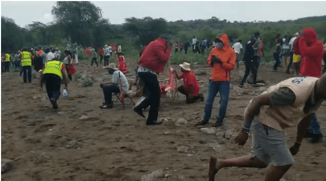 Chaos after car knocks down beehive during Rhino charge unleashing bees at spectators