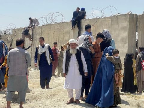 Three killed as Afghan protests test Taliban's promise of peaceful rule