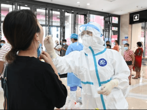 China's strict 21-day quarantine under question after new outbreak emerges